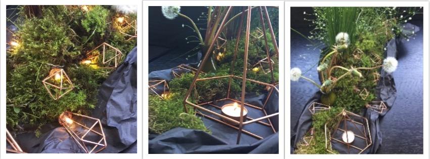 Dunkles Seidenpapier, Moos, Blumen und kupferne Teelichthalter im Origami-Stil bilden ein ansprechendes Ensemble.